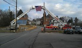 Trucks 87 and 57 (Irwin) flying the stars and stripes for Chief Fink's funeral